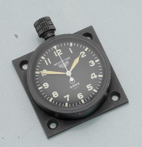 Heuer. A black finished military issue 8-day dashboard timepiece Master Time Ref:6A/11146, Case No.3173, Circa 1968