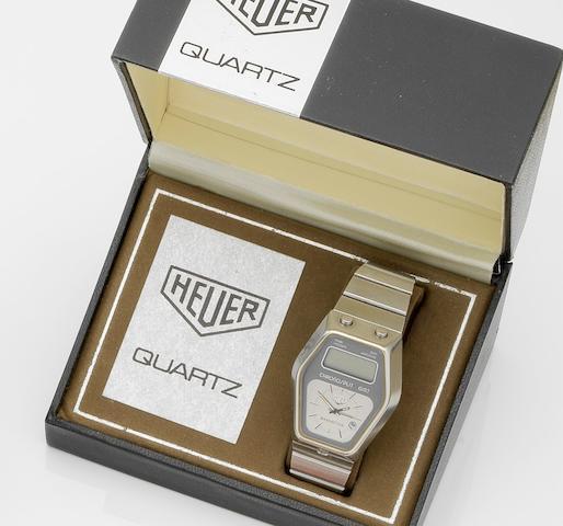 Heuer. A stainless steel quartz dual dial digital calendar chronograph bracelet watch Chronosplit Manhattan GMT, Ref:104.403, Case No.363514, Circa 1978