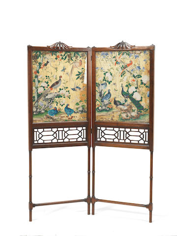 A George II/III mahogany folding firescreen housing two Chinese silk pictures