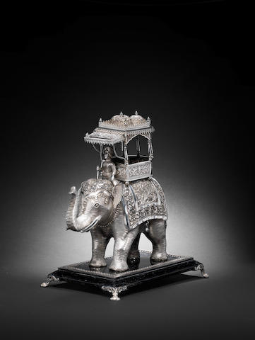 A silver??? model of an elephant and Rider India,