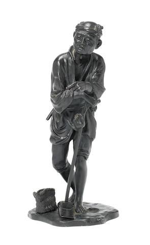 A bronze okimono of a farmer by Genryusai Seiya Meiji