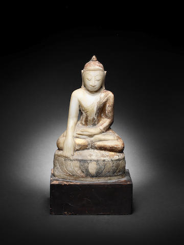 A carved alabaster buddha with remnants of gilding, late 18th/19th Century