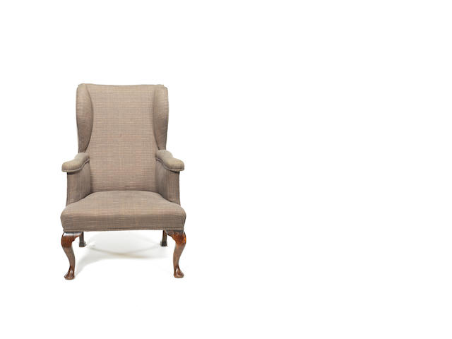 A George I walnut reclining wing armchair