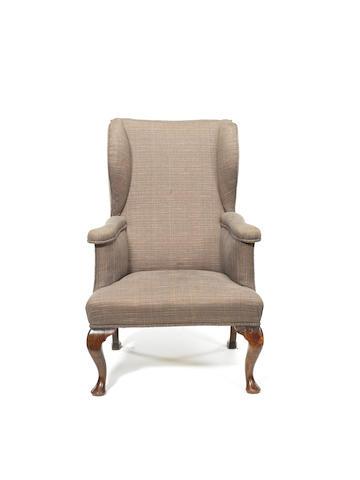 A George I walnut reclining wing armchair