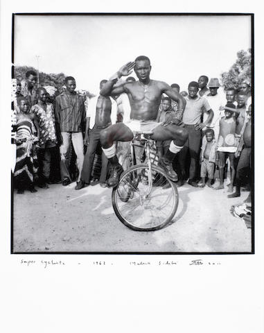 Malick Sidibé (Malian, born 1936) 'Super Cycliste' 50 x 39cm (19 11/16 x 15 3/8in) (sheet size); 35 x 35cm (13 3/4 x 13 3/4in) (sheet size).