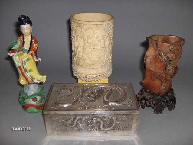 A 19th century Chinese carved ivory brush pot