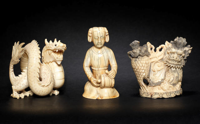 Three small ivory figures