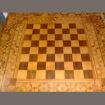An attractive marquetry chess table,
