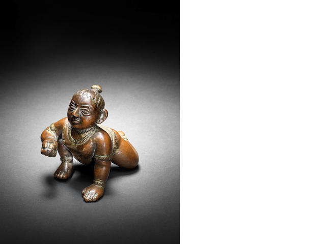 A small bronze figure of Krishna, 17th Century