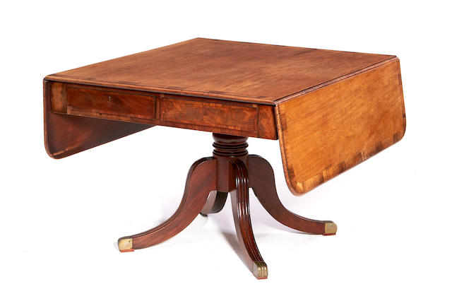 A late Regency mahogany and rosewood crossbanded supper table