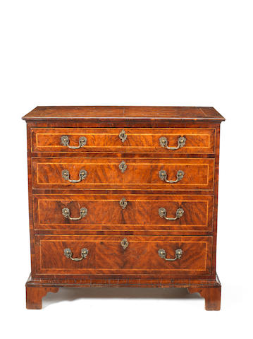 A George III Yew wood chest of four long graduated drawers with ash bandings