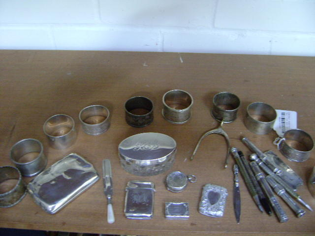 A collective lot of silver samll wares,to include a 19th Century vinigarette (lacks grille0, two vesta cases, two bookmarks, sovereign case, ten napkin rings, six pencils, other items (parcel).