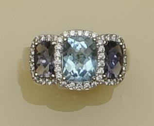 A tanzanite and topaz dress ring
