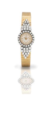 Omega. A fine 18ct gold and diamond set lady's manual wind bracelet watch Circa 1970s
