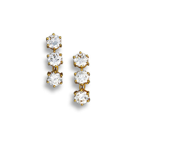 A pair of diamond ear clips
