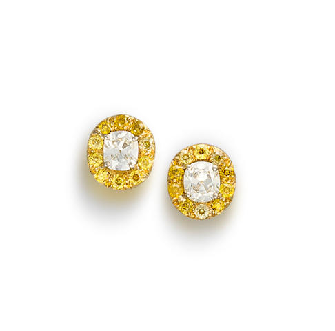 A pair of diamond and coloured diamond earrings