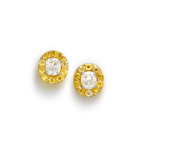 A pair of diamond and coloured diamond earrings