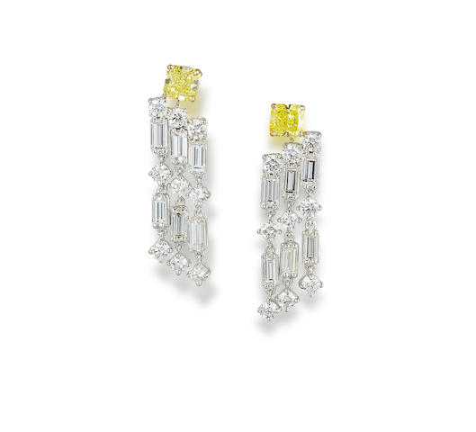A pair of coloured diamond and diamond earrings