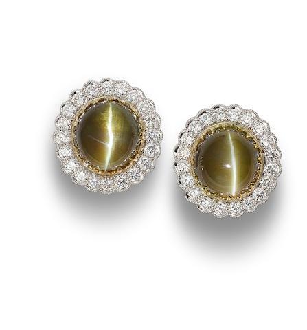 A pair of chrysoberyl cat's eye and diamond earrings