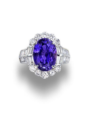 A colour-changing sapphire and diamond ring