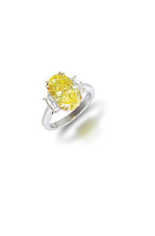 A coloured diamond and diamond ring