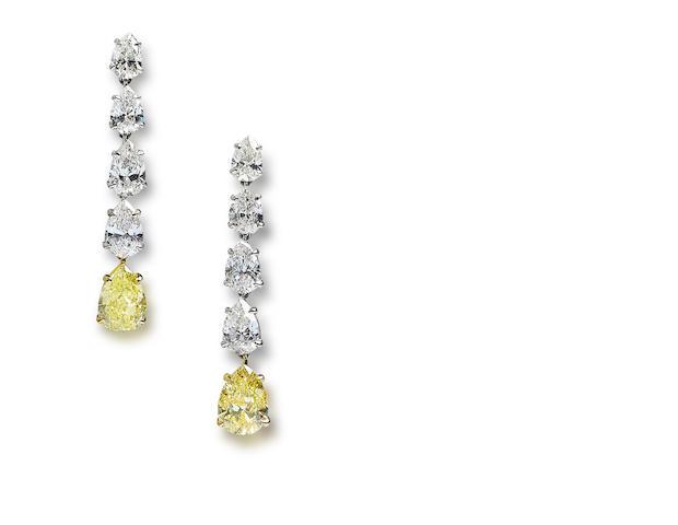 A pair of coloured diamond and diamond earrings