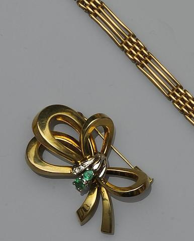 An emerald and diamond bow brooch (4)