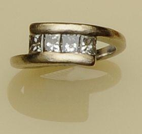 A four stone diamond crossover ring
