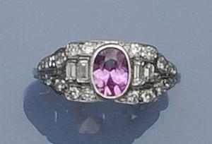 A pink sapphire and diamond panel ring