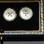 A pair of mother o' pearl and enamel cufflinks