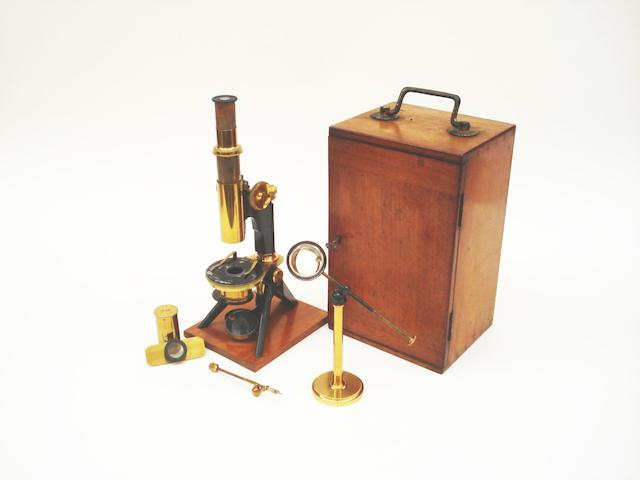 A Charles Baker brass compound monocular microscope,  English,  early 20th century,