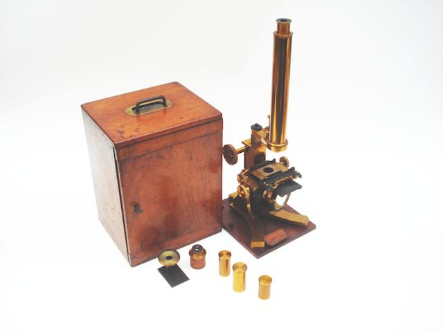 A brass compound monocular microscope,  English,  late 19th century,