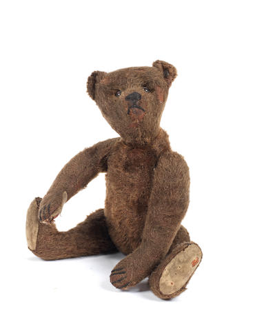 A small dark brown Steiff Teddy Bear, circa 1909
