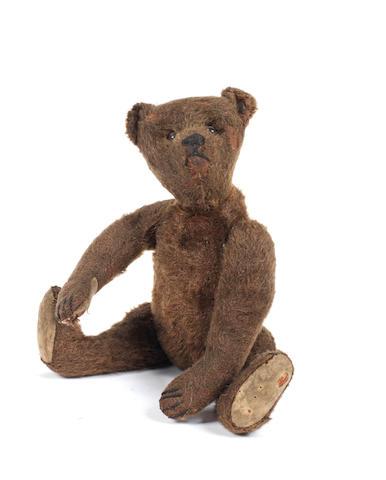A small dark brown Steiff Teddy Bear, circa 1909