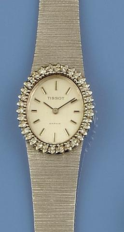 Tissot: An 18ct white gold diamond set lady's wristwatch
