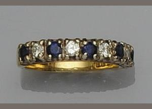 A seven stone sapphire and diamond ring
