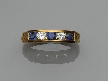 A sapphire and diamond half hoop eternity ring