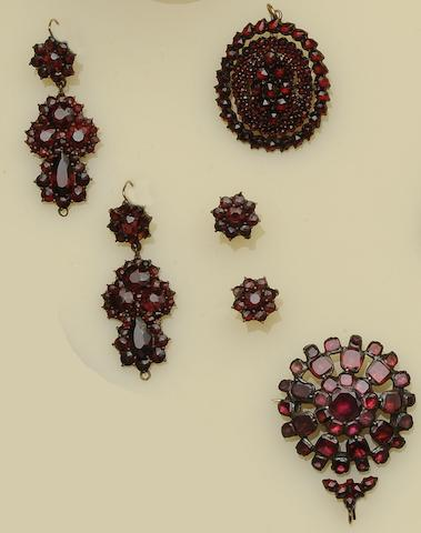 A collection of garnet set jewellery and a shell cameo brooch (5)