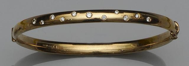 A 9ct gold and diamond hinged bangle