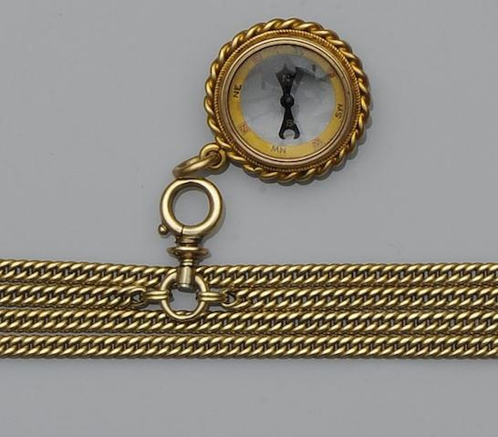A curb-link long chain and compass pendant (2)