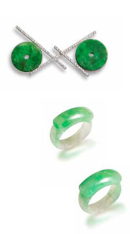 A pair of jadeite saddle rings and a jadeite and diamond pendant (3)