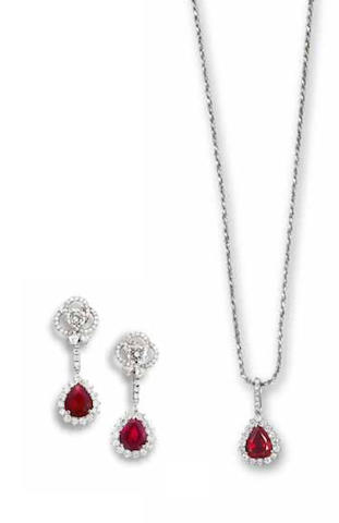 A ruby and diamond pendant necklace and earring suite (2)