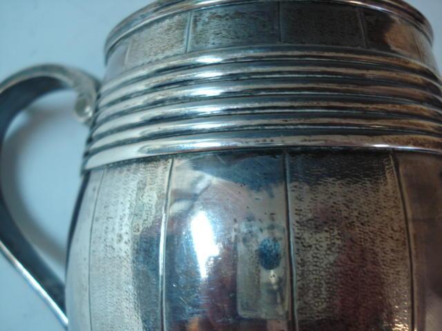 A George III barrel mug of coopered form, scroll handle Thomas Heming, London 1768