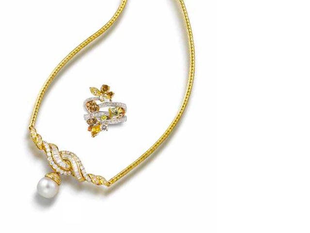 A cultured pearl and diamond necklace and a colored diamond and diamond ring (2)