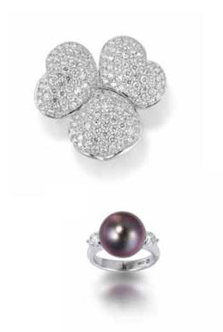 A diamond ring and a cultured pearl and diamond ring (2)
