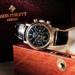 Patek Philippe. A very fine and very rare 18ct rose gold and black dial perpetual calendar chronograph manual wind wristwatch Ref:3970E, Case No.2968310, Movement No.3045354, Made 1995, Sold 17th January 1996