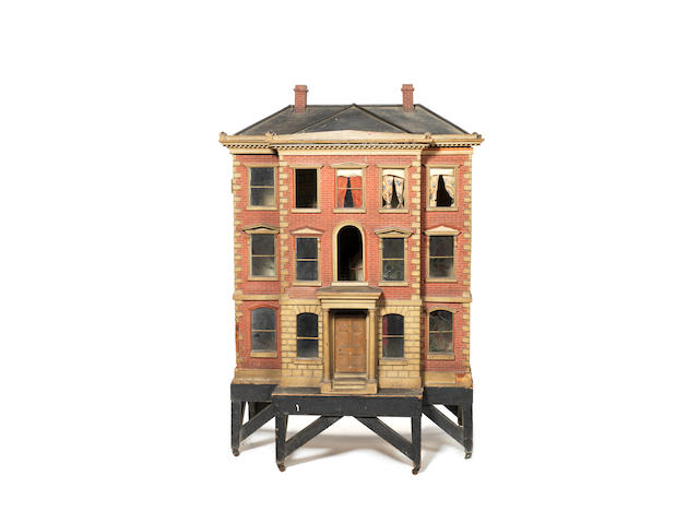 Large early painted red brick wooden dolls house on stand, English circa 1840