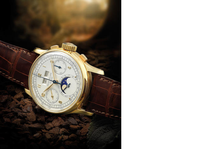 Patek Philippe. A highly rare and important 18ct gold perpetual calendar chronograph manual wind wristwatch with moon phases Ref:1518, Case No.668376, Movement No.868015, Made in 1950