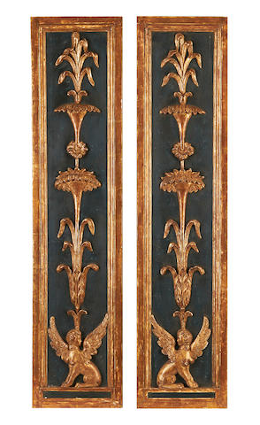 A pair of carved gilded corbels. (2)