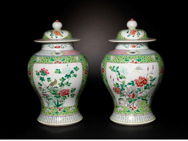 A pair of famille rose, baluster vases and covers